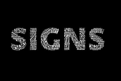 Sort billede med skriften SIGNS